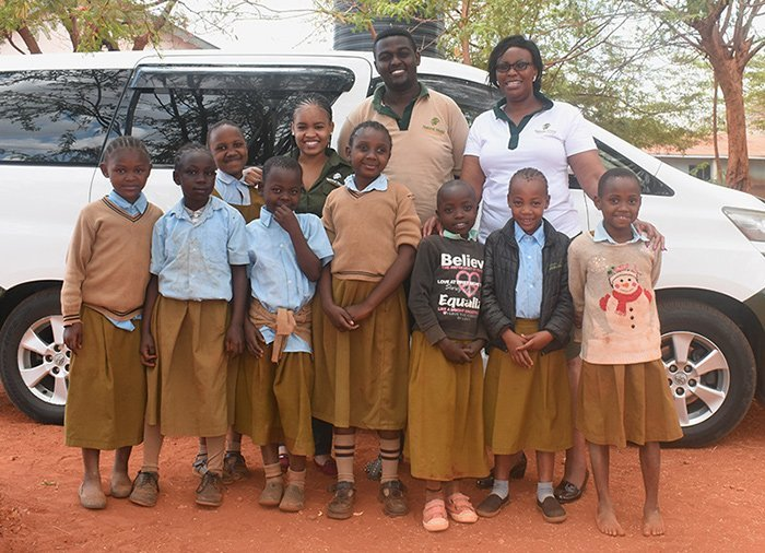 Teacher and children at Mwamunga Primary School